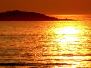 Reflet du coucher de Soleil dans l'océan